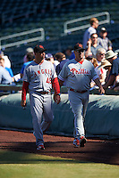 Scottsdale Scorpions pitching coaches Michael Wuertz (48), of the Los Angeles Angels of Anaheim organization and Steve Schrenk (28), of the Philadelphia Phillies organization, walk to the dugout before a game against the Mesa Solar Sox on October 21, 2016 at Sloan Park in Mesa, Arizona.  Mesa defeated Scottsdale 4-3.  (Mike Janes/Four Seam Images)