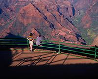 Couple Looking at Spectactular View, Waimea Canyon State Park Lookout, Kauai, Hawaii, USA.