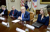 United States President Donald Trump speaks during a listening session on domestic and international human trafficking in the Roosevelt Room of the White House on February 23, 2017 in Washington, DC.  To the President's right is Gary Haugen, CEO and Founder, International Justice Mission and to his left is Michelle DeLaune, COO, National Center for Missing & Exploited Children. <br /> Credit: Olivier Douliery / Pool via CNP