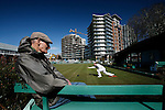 Kris Constable, lawn bowls as longtime lawnbowling member, Ray Turner, has a rest on a bench, at the Canadian Pacific Lawn Bowling Club in downtown Victoria Monday. The city-owned land on which the lawnbowling club sits, is likely to be developed in coming years. Photo assignment for the Globe and Mail national newspaper in Canada.