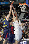 Real Madrid's Felipe Reyes (c) and Ioannis Bourousis (r) and FC Barcelona's Justin Doellman during Euroleague match.February 5,2015. (ALTERPHOTOS/Acero)