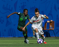 GRENOBLE, FRANCE - JUNE 22: Lina Magull #20 of the German National Team dribbles as Ngozi Okobi #13 of the Nigerian National Team defends during a game between Nigeria and Germany at Stade des Alpes on June 22, 2019 in Grenoble, France.