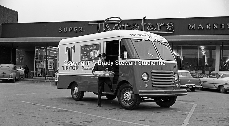 Client:  Ward Baking Company<br /> Ad Agency: None / JBE Olson Corporation<br /> Product: Olson Kurbmasters Parcel Vans<br /> Location: Thorofare Super Market South Hills<br /> <br /> Route driver delivering Tip Top Bread to the Thorofare Super Market. Ward Baking used Olson Kurbmasters which were popular parcel delivery vans in the 1960s. They were built using Ford P-series chassis with a slanting engine compartment and slab-sided front end. Kurbmaster is still copied today by many step-van manufacturers.
