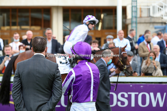 September 11, 2021: Trainer Aidan O'Brien and jockey Ryan Moore prior to the Group 1 Irish Champion Stakes on the turf on Irish Champions Weekend at Leopardstown Racecourse in Dublin, Ireland on September 11th, 2021. Shamela Hanley/Eclipse Sportswire/CSM