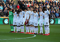 Swansea players observe a minute's silence during the Premier League match between Swansea City and Brighton and Hove Albion at The Liberty Stadium, Swansea, Wales, UK. Saturday 04 November 2017