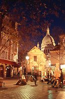 France Paris Place de Tertre with the Sacre Coeur at dusk