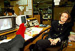 Anna Ford, British television news presenter, at work with Peter Sissons (feet).   BBC News at 6.00 studio. 1990s UK
