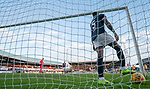 Genseric Kusunga in the net as his Dundee team mate Kevin Holt scored an own goal