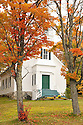 Classic New England foliage framing the entry to a church in Jefferson, NH.