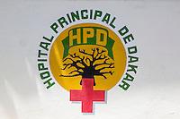 Dakar, Senegal.  Dakar Hospital Emblem with Red Cross and Baobab Tree.