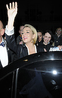 "SHERIDAN SMITH .Departed after the first preview performance of ""Flare Path"", Haymarket, London, England, UK, 4th March 2011..half length hand arm raised up smiling black white .CAP/CAN.©Can Nguyen/Capital Pictures."