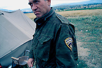 Macedonia police guard Stinkovoca refugee camp in northern Macedonia. The camps hold civilians from Kosovo.<br />