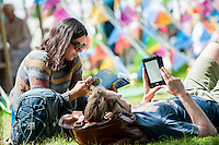 Tuesday 31 May 2016. Hay on Wye, UK<br /> Pictured: A couple relax in the sun at Hay <br /> Re: The 2016 Hay festival take place at Hay on Wye, Powys, Wales