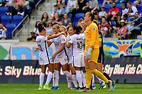 HARRISON, NJ - SEPTEMBER 29: Shelina Zadorsky #4 of the Orlando Pride celebrates scoring with teammates during a game between Orlando Pride and Sky Blue FC at Red Bull Arena on September 29, 2019 in Harrison, New Jersey.