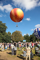 2016 09 18<br /> Pictured: Performer suspended from a giant peach. The Great Pyjama Picnic, Bute Park, Cardiff.Sunday 18 September 2016<br /> Re: Roald DahlÕs City of the Unexpected has transformed Cardiff City Centre into a landmark celebration of WalesÕ foremost storyteller, Roald Dahl, in the year which celebrates his centenary.
