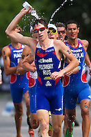 24 JUN 2012 - KITZBUEHEL, AUT - Dmitry Polyanskiy (RUS) of Russia pours water over his head as he tries to cool himself during the run at the elite men's 2012 World Triathlon Series round in Schwarzsee, Kitzbuehel, Austria (PHOTO (C) 2012 NIGEL FARROW)