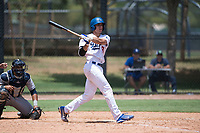 AZL Dodgers catcher Aaron Ackerman (9) follows through on his swing in front of catcher Luis Roman (4) during an Arizona League game against the AZL Padres 2 at Camelback Ranch on July 4, 2018 in Glendale, Arizona. The AZL Dodgers defeated the AZL Padres 2 9-8. (Zachary Lucy/Four Seam Images)
