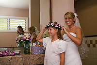 A bride and flower girl prepare for a wedding in Kailua