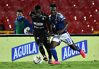 BOGOTA-COLOMBIA, 19-09-2020: Elvis Perlaza de Millonarios y Pablo Rojas de Once Caldas disputan el balon, durante partido entre Millonarios y Once Caldas de la fecha 9 por la Liga BetPlay DIMAYOR I 2020 jugado en el estadio Nemesio Camacho El Campin de la ciudad de Bogota. / Elvis Perlaza of Millonarios and Pablo Rojas de Once Caldas figth for the ball, during a match between Millonarios and Once Caldas of the 9th date for the BetPlay DIMAYOR Leguaje I 2020 played at the Nemesio Camacho El Campin Stadium in Bogota city. / Photo: VizzorImage / Luis Ramirez / Staff.