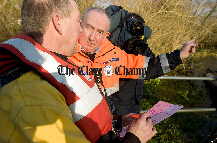Mattie Shannon,Doolin Cliff Coast Rescue and Liam Griffin,Civil Defence Officer Clare County Council discuss the search operation on the banks of the River Fergus.Pic Arthur Ellis.