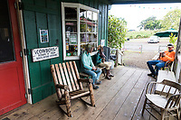 A visitor relaxes on the porch at Ulupalakua Ranch, Maui.