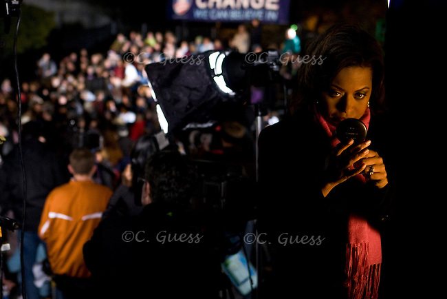A TV news reporter touches up her makeup on a riser before Senator Barack Obama's Texas primary victory speech in San Antonio, Texas..