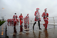 Pictured: Runners in Santa Claus fancy dress during this year's run in Aberavon, Wales, UK. Saturday 15 December 2018<br /> Re: 500 people have taken part in Run4All Santa 5km Run on Aberavon Promenade near Port Talbot, Wales, UK.