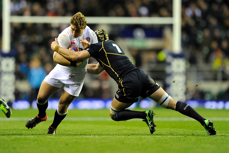 Tom Youngs of England is tackled by Kelly Brown of Scotland during the RBS 6 Nations match between England and Scotland at Twickenham on Saturday 02 February 2013 (Photo by Rob Munro)