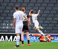 Lincoln City's Alex Palmer saves at the feet of Milton Keynes Dons' Callum Brittain<br /> <br /> Photographer Chris Vaughan/CameraSport<br /> <br /> The EFL Sky Bet League One - Milton Keynes Dons v Lincoln City - Saturday 19th September 2020 - Stadium MK - Milton Keynes<br /> <br /> World Copyright © 2020 CameraSport. All rights reserved. 43 Linden Ave. Countesthorpe. Leicester. England. LE8 5PG - Tel: +44 (0) 116 277 4147 - admin@camerasport.com - www.camerasport.com