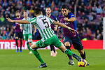 Luis Alberto Suarez Diaz of FC Barcelona (R) is tackled by Marc Bartra Aregall of Real Betis during the La Liga 2018-19 match between FC Barcelona and Real Betis at Camp Nou, on November 11 2018 in Barcelona, Spain. Photo by Vicens Gimenez / Power Sport Images