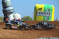 Apr 16, 2011; Surprise, AZ USA; LOORRS driver Kyle Leduc (99) races with Travis Coyne (5) and Steve Barlow (83)  during round 3 at Speedworld Off Road Park. Mandatory Credit: Mark J. Rebilas-.
