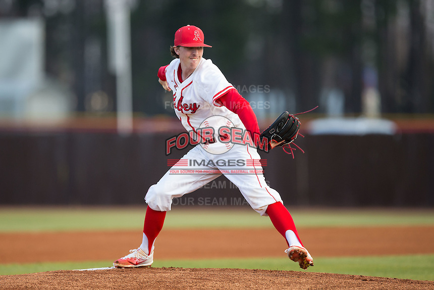 Belmont Abbey Crusaders starting pitcher Cameron Busby (9) in action against the Catawba Indians at Abbey Yard on February 7, 2017 in Belmont, North Carolina.  The Crusaders defeated the Indians 12-9.  (Brian Westerholt/Four Seam Images)