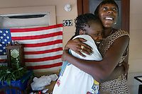 """Lydia Carter, left,  gets a supportive hug after she hears the story about twenty years of addiction from HIV/AIDS Intervention Specialist Lynnett Robinson, of the Outreach Community Care Network as she explains the risks of unprotected sex on her community outreach rounds in DeLand Wednesday June 25, 2003. """"We are losing a whole generation of 'our' (African-Americans) people to this disease"""", explains Lynnett as she shares her stories of addiction and prostitution during her efforts to educate people about safe sex and protecting themselves from contracting the disease..(Kelly Jordan)..**FOR ANDY STORY**.**NOTE:LYDIA IS NOT HIV POSITIVE BUT WAS WILLING TO RECEIVE INFORMATION FROM LYNNETT**"""