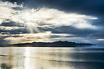 Storm clouds, Great Salt Lake, Utah.  Viewed from Great Salt Lake State Park, Salt lake City area.  Sailing regatta on calm waters.  Anelope Island in background.