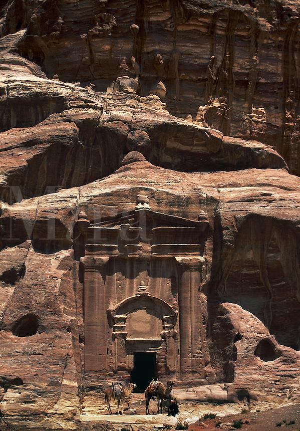 The Renaissance Tomb a rock cut temple with camels Petra JORDAN.