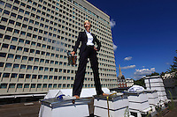 """Joel Hemesley in a suit on the hives of the Royal Lancaster Hotel.  Just a stone's throw from Hyde Park, the hotel's bees have been gathering honey from the flowers in the royal gardens. Joel joined the hotel's green team, which takes of the hives, the idea being to produce local honey to serve to guests but also to help the bees survive. """"With the help of our mentor, Luke Dixon, fives hives were set up in the summer of 2009 and today we have ten. My work at the hotel is no picnic: I'm part of the managing team and I handle corporate sales to foreign companies and I travel a lot. My first encounter with bees occurred in school when I was twelve years old. At that time, in the context of the Duke of Edinburgh's program, we were supposed learn a trade and I chose apiculture. I hadn't reopened a hive until we put into place the hives at the hotel. Bees are really fascinating creatures. I love the way the life is organized around the colony. Each bee has a role to play in the population's survival and I love feeling that harmony."""