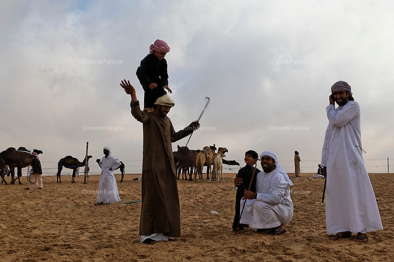 Families gather and pass time waiting for their camels to be judged. The contest is as much about family pride as it is about prizes or camel perfection.