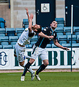 Dundee's James McPake goes into the back of Caley's Gary Warren.