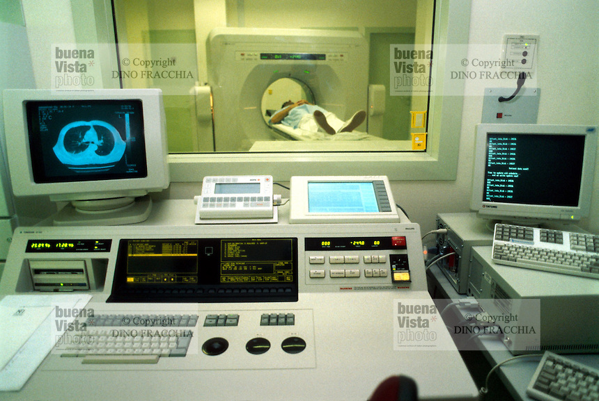 - patient under CAT (computed axial tomography) ....- Istituto Clinico Humanitas, paziente sotto TAC..(tomografia assiale computerizzata)