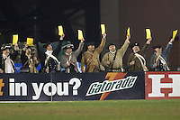 The Revolution color guard hold up yellow card warnings in the second half of the MLS Eastern Conference Final. The New England Revolution defeated the Chicago Fire, 1-0, on November 6 at Gillette Stadium.