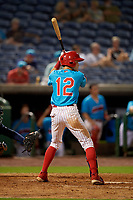 Clearwater Beach Dogs Simon Muzziotti (12) bats during a Florida State League game against the Charlotte Stone Crabs on July 26, 2019 at Spectrum Field in Clearwater, Florida.  Clearwater defeated Charlotte 6-5.  (Mike Janes/Four Seam Images)