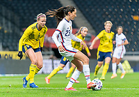 SOLNA, SWEDEN - APRIL 10: Christen Press #23 of the USWNT passes the ball during a game between Sweden and USWNT at Friends Arena on April 10, 2021 in Solna, Sweden.