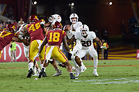 LOS ANGELES, CA - SEPTEMBER 11: Tanner McKee #18 of the Stanford Cardinal looks to pass the ball with protection from Austin Jones #20 during a game between University of Southern California and Stanford Football at Los Angeles Memorial Coliseum on September 11, 2021 in Los Angeles, California.
