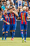 Luis Suarez of FC Barcelona celebrates with teammates Lionel Messi and Neymar JR during their La Liga match between Deportivo Leganes and FC Barcelona at the Butarque Municipal Stadium on 17 September 2016 in Madrid, Spain. Photo by Diego Gonzalez Souto / Power Sport Images