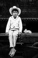 A Mexican boy, wearing white cowboy clothes, sits on the wagon of the legendary Chihuahua-Pacífico train in the nothern Mexico, 20 September 1998.