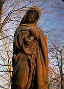 Old weathered statue in an scenic New England graveyard