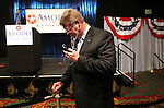 Former Republican state senator Mark Amodei takes a phone call from the National Republican Committee chairman after taking the lead in Nevada's special election to fill a U.S. House seat, during an election night event in Reno, Nev., Sept. 13, 2011. (AP Photo/Cathleen Allison)