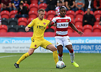 Fleetwood Town's Peter Clarke chases down Doncaster Rovers' Niall Ennis<br /> <br /> Photographer David Shipman/CameraSport<br /> <br /> The EFL Sky Bet League One - Doncaster Rovers v Fleetwood Town - Saturday 17th August 2019  - Keepmoat Stadium - Doncaster<br /> <br /> World Copyright © 2019 CameraSport. All rights reserved. 43 Linden Ave. Countesthorpe. Leicester. England. LE8 5PG - Tel: +44 (0) 116 277 4147 - admin@camerasport.com - www.camerasport.com