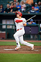 Memphis Redbirds first baseman Luke Voit (35) follows through on a swing during a game against the Round Rock Express on April 28, 2017 at AutoZone Park in Memphis, Tennessee.  Memphis defeated Round Rock 9-1.  (Mike Janes/Four Seam Images)