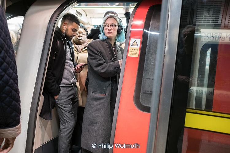 Crowded rush hour tube train at London Bridge underground station.